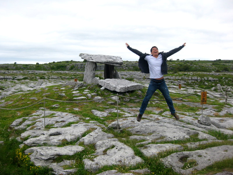 The hubs having a ball of time at the Poulnabrone dolmen, the Burren.